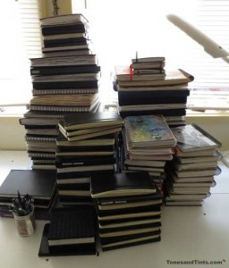 Studio Journals stacked on a table