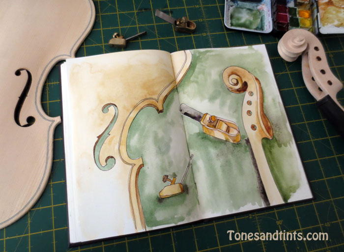 Violin parts and luthier planes on table