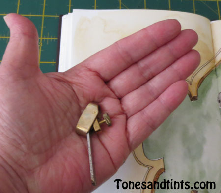 luthiers tool in hand