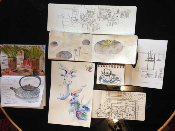 sketchbooks on table